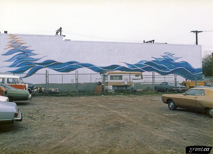 1986 09 19 Brewery Creek Mural Project light grey building blue designs Linda Neville