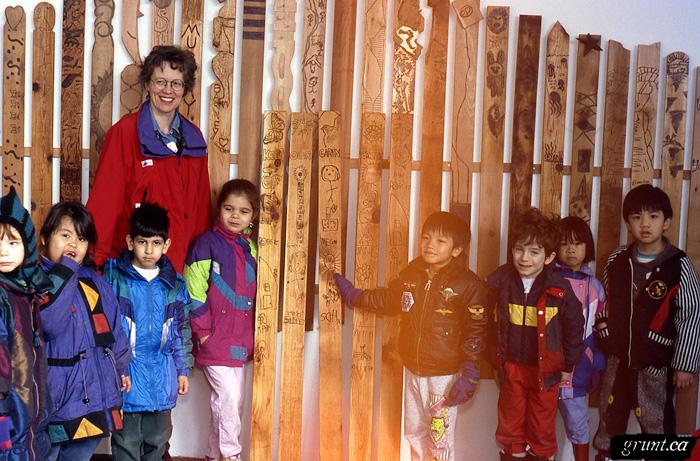 1994 03 Mount Pleasant Community Fence Project 003 grunt interior Nightingale school student visiting exhibition holding their fence picket