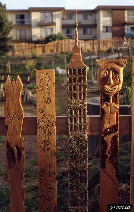 1994 03 Mount Pleasant Community Fence Project detail red cedars pickets empire state building human figure abstract earth drawing