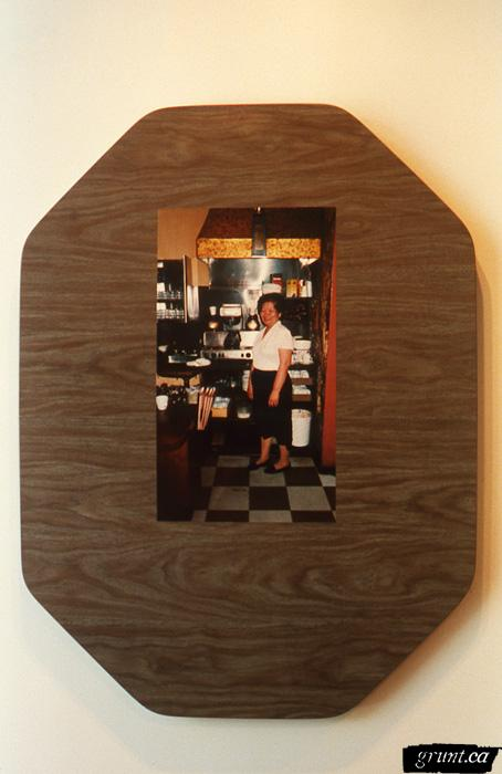 1996 06 04 The Mattering Map Project Pia Massie 11 detail woman standing in diner mounted dark wood grain counter top